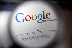epa02473923 An image made with a magnifying glass effect showing a part of the homepage of internet search engine Google, Cologne, Germany, 30 November 2010. The European Union (EU) is to launch an anti-trust probe into Google following claims that its search engine manipulates results to harm rivals, EU officials announced 30 November. The investigation comes after complaints from some of Google's business rivals. The European Commission stressed that the launch of a probe does not mean Google is guilty.  EPA/OLIVER BERG