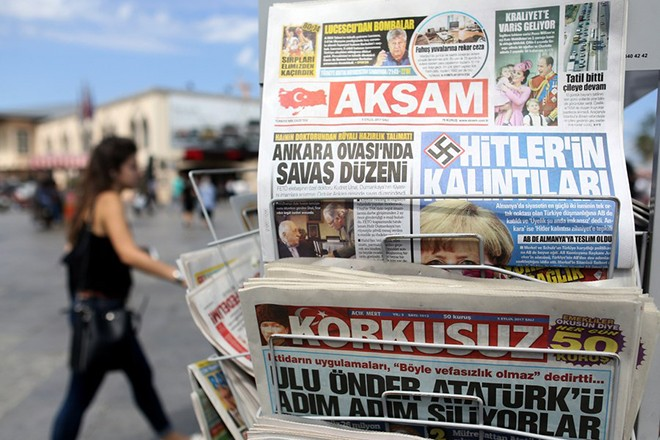 epa06184883 A view of Turkish Aksam newspaper with a headline 'Ruins of Hitler' (C-R) depicting German Chancellor Angela Merkel, in Istanbul, Turkey, 05 September 2017. After the German elections television debate between Merkel and Social Democrat challenger Martin Schulz on 03 September, Turkish President Recep Tayyip Erdogan accused them of 'bowing down to populism and prejudice' after both said they would seek an end to membership talks between the EU and Turkey.  EPA/ERDEM SAHIN