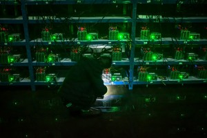 epaselect epa06062675 (04/26) Bitcoin miner Huang inspects a malfunctioning mining machine during his night shift at the Bitcoin mine in Sichuan Province, China, 26 September 2016. Miners can check a machine's condition and operations using phones and personal computers. For most issues, they can simply restart a machine. 'If it's a complicated problem, we just ship it to the factory and let them fix it,' Huang said. China is one the main exchange market of bitcoins although the digital currency exists in a legal limbo and prone to speculation. The country hosts some of the biggest 'mining pools' in the world, clusters of supercomputers which task is minting new bitcoins and maintaining the system, sometimes installed in shady places close to power plants. Sichuan has become known as 'the capital of bitcoin mining' as entrepreneurial Chinese set up 'mines' there due to its abundance of hydropower, perfect for the high electricity needs of the large number of computers required for Bitcoin mining. Bitcoin mines are buildings with warehouse-like structures equipped with massive numbers of microprocessors with which 'miners' solve complex math problems and are rewarded in the digital currency. The industry exists in a legal gray zone in China, and the miners in this story, concerned about attention from the government, asked not to have their full names or the names of the villages where their mines are located mentioned in this story.  EPA/LIU XINGZHE/CHINAFILE ATTENTION: For the full PHOTO ESSAY text please see Advisory Notice epa06062671
