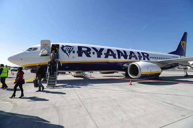 epa06146939 (FILE) - Passengers disembark a Ryanair passenger plane at Frankfurt airport in Frankfurt am Main, Germany, 28 March 2017. Reports on 16 August 2017 state the Irish low-cost airline has sent a complaint to German Federal Cartel Authority and EU competion authority, accusing Germany's biggest airline Lufthansa, Air Berlin and German government of a plot aimed at making it possible for Lufthansa to take over bankrupt Air Berlin without its liabilities and debt. Air Berlin filed for insolvency proceedings on 15 August 2017.  EPA/ARMANDO BABANI