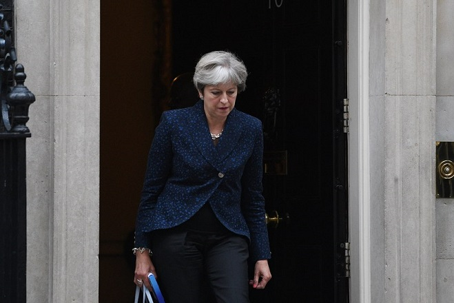 epa06189524 British Prime Minister, Theresa May leaves her London residence, 10 Downing street, in c entral London, Britain, 07 September 2017, to attend a EU withdrawal bill debate in the Britsih Houses of Parliament in Westminster.  EPA/FACUNDO ARRIZABALAGA