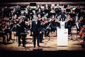 epa06202335 A handout photo made available by the ABB press office shows Italian tenor Andrea Bocelli (C-front) performing at a classical concert conducted by robot YuMi during the opening of the International Robotics Festival in Pisa, Italy, 12 September 2017 (issued 13 September). Bocelli sang 'La donna e mobile' (The lady is fickle) from Giuseppe Verdi's opera Rigoletto. The Swiss-made robot YuMi was programmed to imitate the movements of Lucca Philarmonic Orchestra director Andrea Colombini. The robot would not be able to improvise and lead musicians on its own. There have been other examples of robot-conducted orchestra in the past. The first time was in 2008, when a Japanese-designed machine led the Detroit Symphony Orchestra.  EPA/ABB PRESS OFFICE HANDOUT  HANDOUT EDITORIAL USE ONLY/NO SALES