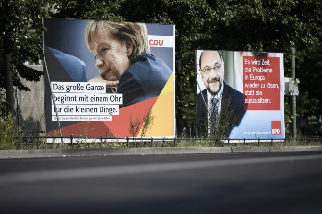 epa06173495 German Chancellor and Chairwoman of the German Christian Democratic Union (CDU) party, Angela Merkel (L) and her challenger, the leader of the German Social Democratic Party (SPD) and candidate for chancellor, Martin Schulz (R), are pictured on campaign posters in Berlin, Germany, 31 August 2017. German general elections are being held on 24 September 2017  EPA/CLEMENS BILAN