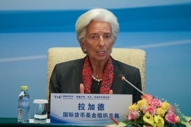 epa06199191 The Managing Director of the International Monetary Fund (IMF) Christine Lagarde speaks to the media during a joint press conference following the 1+6 Round Table Dialogue meeting at the Diaoyutai State Guesthouse in Beijing, China, 12 September 2017.  EPA/ROMAN PILIPEY