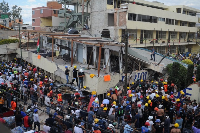 epa06214802 Rescue team members work at the Enrique Rebsamen school after a 7.1 magnitude earthquake, in Mexico City, Mexico, 19 September 2017. At least 20 children and two adults were killed and 38 others are missing after a school building collapsed in Mexico City following a 7.1 magnitude earthquake which shook the country. At least 149 people died in the states of Morelos, Puebla and Mexico following a powerful earthquake that struck central Mexico. Emergency services are searching for survivors buried under the rubble of collapsed buildings. The death toll is likely to rise, media added quoting officials.  EPA/STR