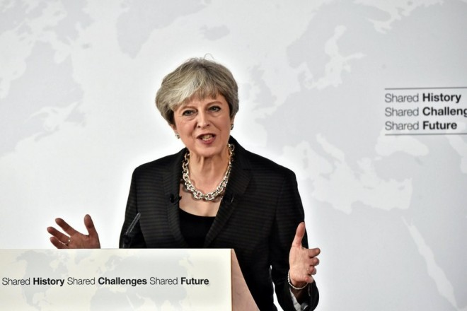 epa06219886 British Prime Minister Theresa May delivers her speech on Brexit in Florence, Italy, 22 September 2017. Theresa May proposed a two-year transitional deal before a permanent trade deal comes into force, after UK leaves the European Union.  EPA/MAURIZIO DEGL'INNOCENTI / POOL
