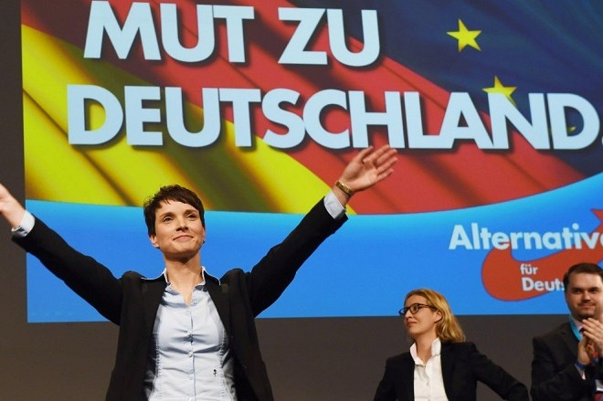 Leader of populist-nationalist Alternative for Germany (AfD) party, Frauke Petry gestures on stage after delivering a speech at the party's congress in Hannover, central Germany, on November 28, 2015. AFP PHOTO / DPA / SWEN PFÖRTNER   GERMANY OUT