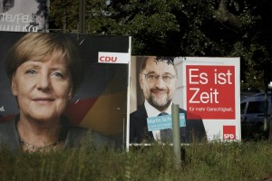 epa06212437 German Chancellor and Chairwoman of the German Christian Democratic Union (CDU) party, Angela Merkel (L), and her challenger, the leader of the German Social Democratic Party (SPD) and candidate for chancellor, Martin Schulz (R), are pictured on campaign posters of their respective parties, in Berlin, Germany, 18 September 2017. General elections in Germany are scheduled for 24 September 2017.  EPA/CARSTEN KOALL