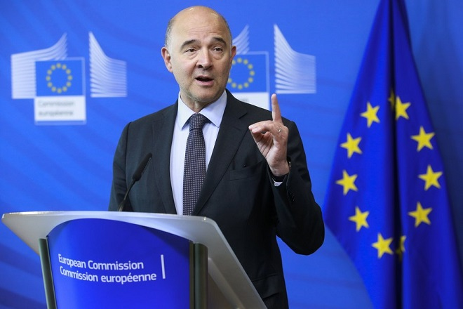 epa06083150 Pierre Moscovici, European Commissioner for Economic and Financial Affairs, Taxation and Customs gives a press briefing as the Commission has decided to recommend to the Council to close the Excessive Deficit Procedure (EDP) for Greece in Brussels, Belgium, 12 July 2017.  EPA/OLIVIER HOSLET