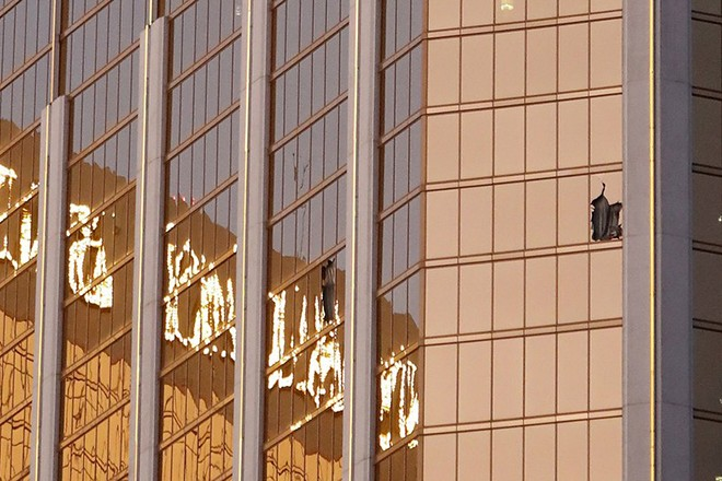epa06240076 Broken windows seen on a high floor in the Mandalay Bay hotel facing the scene of the mass shooting at the Route 91 Harvest festival on Las Vegas Boulevard in Las Vegas, Nevada, USA, 02 October 2017. Police reports indicate that a gunman firing from an upper floor in the Mandalay Bay hotel killed at least 50 people and injured more than 400 before police he was killed by police.  EPA/PAUL BUCK