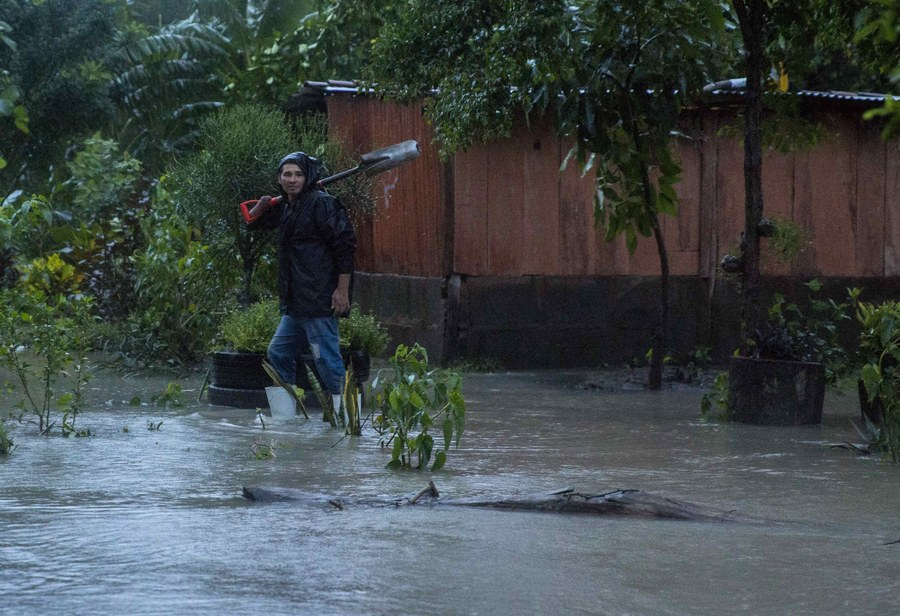 epa06247490 A man walks amid flood waters after the passing of the Storm Nate in the Iguanal community, in Rivas, Nicaragua, 05 October 2017. At least 22 people were killed, 11 of them in Nicaragua, and 10 missing in Central America, as heavy rains brought by tropical storm Nate flooded areas affecting buildings and plantations.  EPA/JORGE TORRES
