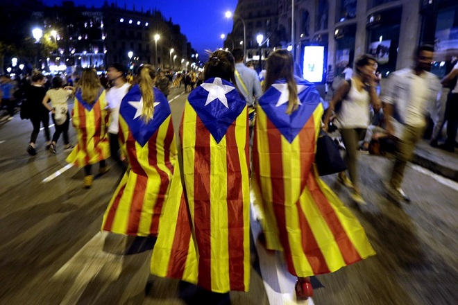 epa06243525 Catalan people wearing pro-independence 'Estelada' regional flags leave after taking part in a protest at the Barcelona University's square against the Spanish police forces' actions during the '1-O Referendum', in Barcelona, northeastern Spain, 03 October 2017 (issued 04 October 2017). Catalan President Carles Puigdemont, has stated during an interview granted to British channel BBC that Catalonia will declare the independence from Spain in a matter of days. Meanwhile Spain's King Felipe VI gave an institutional statement in which he warned on the 'extremly serious' situation in Catalonia in which he said that the 'legitime powers of State' must guarantee 'the constitutional order', the operation of the rule of law and the self-government in Catalonia, based in the Constitution and its autonomy statute.  EPA/ALBERTO ESTEVEZ