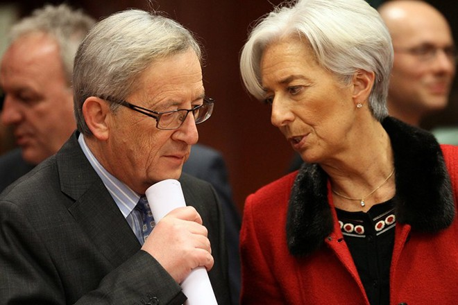 epa03098405  International Monetary Fund (IMF) Managing Director Christine Lagarde (R) and  President of the Euro group Luxembourg's Prime Minister Jean-Claude Juncker chat  at the start of a Euro Group  finance ministers council  at the EU  headquarters in Brussels, Belgium, 09 February 2012. Eurozone finance ministers were due to discuss a second bailout package for Greece over dinner, hours after the government in Athens agreed to adopt harsh new austerity measures and struck a debt write-off deal with private creditors. 'Negotiations with representatives of the European Union, the International Monetary Fund (IMF) and the European Central Bank (ECB) have been successfully concluded,' Greek Prime Minister Lucas Papademos said in Athens  EPA/OLIVIER HOSLET