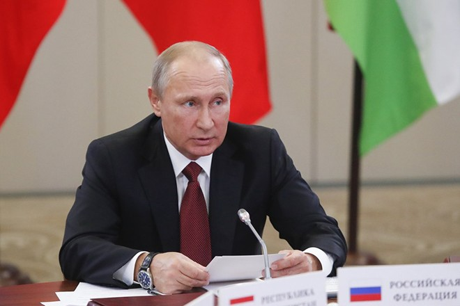 epa06258978 Russian President Vladimir Putin attends a session of the Council of Heads of the Commonwealth of Independent States (CIS) in the Black sea resort of Sochi, Russia, 11 October 2017. During the meeting the leaders discuss cooperation within the Commonwealth.  EPA/MAXIM SHEMETOV / POOL