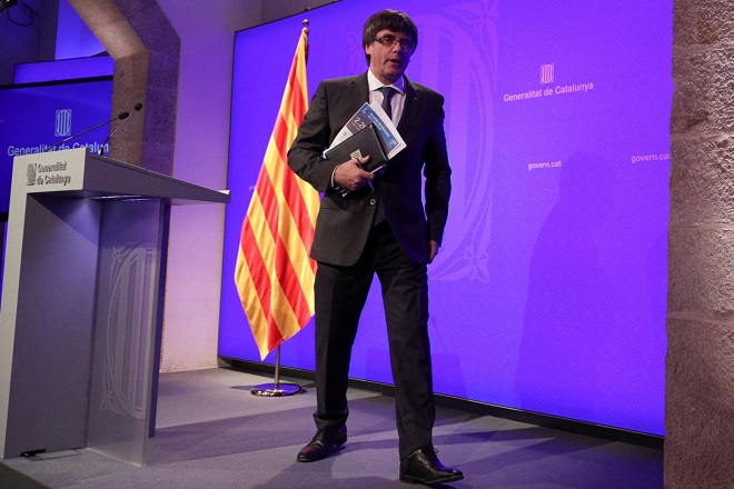 Catalan President Carles Puigdemont leaves the stage after a news conference at Generalitat Palace in Barcelona, Spain, October 2, 2017. REUTERS/Albert Gea