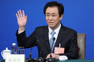 epa05837810 Xu Jiayin, Standing Committee Member of the 12th CPPCC National Committee; Board Chairman of Evergrande Group, waves hands during a press conference on the sidelines of the fifth session of the 12th Chinese People's Political Consultative Conference (CPPCC) in Beijing, China, 09 March 2017. The CPPCC is the top advisory body of the Chinese political system and runs alongside the annual plenary meetings of the 12th National People's Congress (NPC), together known as 'Lianghui' or 'Two Meetings'.  EPA/WU HONG