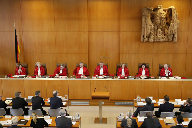 """epa05951961 (L-R) Judges Christine Langenfeld, Doris Koenig, Peter Mueller, Peter M. Huber, presiding judge Andreas Vosskuhle, Monika Hermanns, Sibylle Kessal-Wulf, Ulrich Maidowski of the second senate of the German Constitutional Court speaks during their oral hearing on """"Information of the Parliament on 'Information of the Parliament on financial market supervision and Deutsche Bahn AG' at the Constitutional Court in Karlsruhe, Germany, 09 May 2017. The Federal Constitutional Court is negotiating a dispute between the members of the German Bundestag and the German Bundestag, Buendnis 90 / Die Gruenen, against the Federal Government.  EPA/RONALD WITTEK / POOL"""