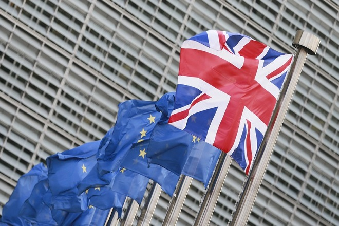 epa06269656 A single British Union flag flies next to European Union flags in front of European commission headquarters in Brussels, Belgium, 16 October 2017, ahead to the visit of  British Prime Minister Theresa May. Prime Minister Theresa May is meeting with EU Commissioner President Juncker and Michel Barnier, the European Chief Negotiator of the Task Force for the Preparation and Conduct of the Negotiations with the United Kingdom under Article 50.  EPA/OLIVIER HOSLET