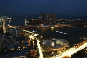 epa06204120 A general view of the skyline of the Marina Bay Sands and illuminated portion of Marina Bay Street Circuit race track in Singapore, 14 September 2017. The Singapore Formula One Grand Prix will take place on 17 September 2017.  EPA/LYNN BO BO