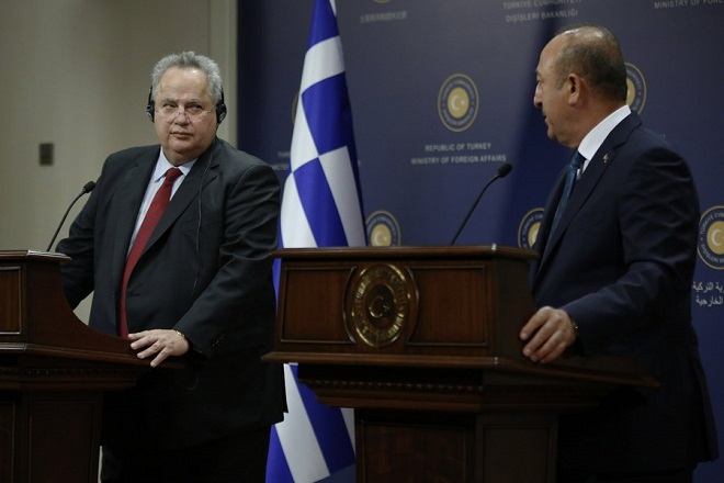 epa06286549 Greek Foreign Minister Nikos Kotzias (L) and Turkish counterpart Mevlut Cavusoglu (R) attend their press conference in Ankara, Turkey, 24 October  2017. According to reports, Kotzias is visiting Turkey where he had talks that focused on the illegal migrants flow from Turkey to Greece and the Greek decision not to extradite eight Turkish officers allegedly accused in the failed coup.  EPA/TUMAY BERKIN