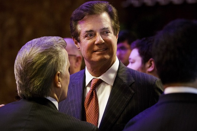 epa05794362 (FILE) - Paul Manafort (C), then campaign advisor for US President Donald J. Trump, talks with supporters and staff after a speech by Trump on the eve of his Indiana primary victory in New York, New York, USA, 03 May 2016 (reissued 15 February 2017). According to media reports on 15 February 2017 citing US intelligence officials, Manafort allegedly was among the Trump aides involved in communication with Russian officials during the election campaign.  EPA/JUSTIN LANE