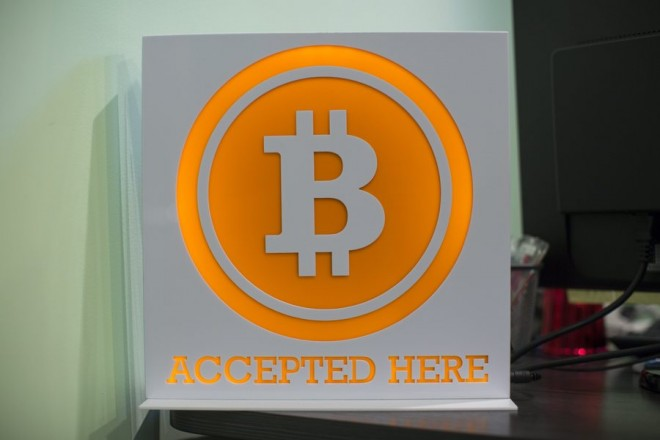 epa05060735 (FILE) A file photograph dated 13 March 2014 shows a Bitcoin sign in the lobby of the ANX office headquarters in Hong Kong, China. Reports on 09 December 2015 state that police have raided the home of an Australian entrepreneur who has been identified in US media as a founder and developer of online digital currency bitcoin.  EPA/JEROME FAVRE