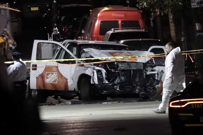 epa06300980 Authorities investigate the pickup truck and scene of a terror attack in downtown New York, New York, USA, 31 October 2017.  Eight people were killed in the incident, and at least 11 were injured when the driver of a pickup truck ran pedestrians and bicyclists down in a bike lane. He then collided with  a school bus injuring people including two children in the bus. The driver was taken into custody after being shot by police. The incident is being investigated as a terror attack.  EPA/JASON SZENES