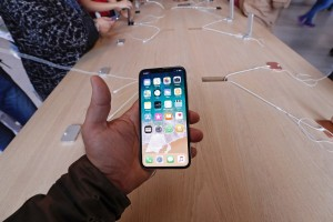 epa06306025 A customer holds an Apple iPhone X on its sale start at Apple store in Madrid, Spain, 03 November 2017. Apple launched its news iPhone X 03 November marking the 10-year anniversary of the first ever iPhone. Apple's new iPhone X goes on sale in more than 55 countries.  EPA/Javier Lizon