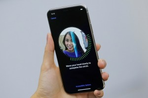 An attendee uses the Face ID function on the new iPhone X during a presentation for the media in Beijing, China October 31, 2017. REUTERS/Thomas Peter - RC1909DB4F00