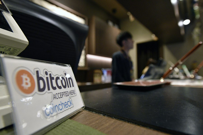 epa06062759 A bitcoin sign is seen at the reception desk of the Anshin Oyado Shinjuku Ekimae capsule hotel in Tokyo, Japan, 03 July 2017. Japan is one the first countries to have recognised bitcoin and the digital currency can be used in a growing number of businesses such as capsule hotels, utilities and restaurants.  EPA/FRANCK ROBICHON