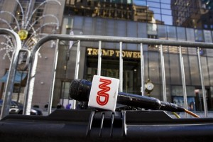 epa05642806 A CNN mic is seen across the street from Trump Tower in New York, New York, USA, on 22 November 2016. Representatives from a number of major television networks attended an off--the- record meeting with US President-elect Donald Trump on Monday, a meeting in which Trump reportedly criticized many of them for their work during the election.  EPA/JUSTIN LANE