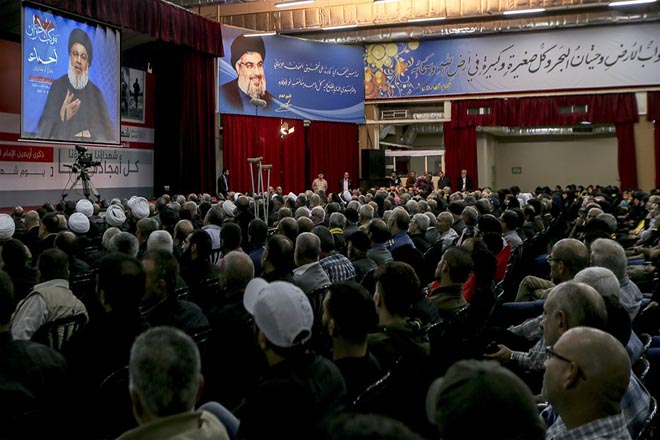 epa06320760 Supporters of Hezbollah listens to Hezbollah leader Hassan Nasrallah via video link, during a rally marking Hezbollah's Martyrs' Day, in the southern suburb of Beirut, Lebanon, 10 November 2017. Nasrallah said that Lebanese prime minister Saad Hariri is currently detained in Saudi Arabia and they 'forced' him for to resign, also said that he have a confirmed information that Saudi Arabia asked Israel to launch a war against Lebanon and Hezbollah.  EPA/NABIL MOUNZER