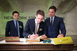 epa05826765 A handout photo made available by the New York Stock Exchange, NYSE, on 02 March  2017 showing from L-R Bobby Murphy, Co-Founder & CTO, Snap Inc.; Evan Spiegel, Co-Founder & CEO, Snap Inc.; and Tom Farley, President, NYSE during signing of documents at the New York Stock Exchange (NYSE) during the Snap Inc. IPO, New York, USA. Snap Inc. was being priced at 17 USD per share which gave the company a value of nearly some 24 billion USD.  EPA/VALERIE CAVINESS HANDOUT  HANDOUT EDITORIAL USE ONLY/NO SALES