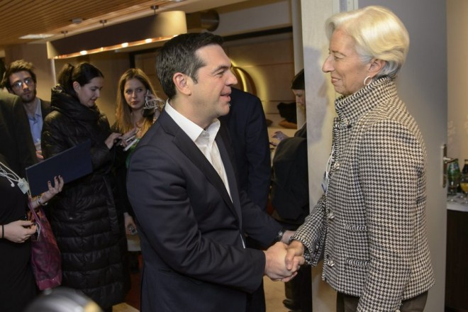 epa05116646 Greece's Prime Minister Alexis Tsipras (L) shakes hands with the Managing Director of the International Monetary Fund (IMF), Christine Lagarde (R), during a bilateral meeting at the 46th Annual Meeting of the World Economic Forum, WEF, in Davos, Switzerland, 21 January 2016. The overarching theme of the meeting, which is expected to gather some 2,500 leading politicians, UN executives, heads of major corporations, NGO leaders and artists at the annual four-day gathering taking place from 20 to 23 January, is 'Mastering the Fourth Industrial Revolution'.  EPA/JEAN-CHRISTOPHE BOTT