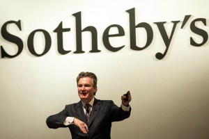 epa06240864 London based Sotheby's auctioneer Henry Howard-Sneyd gestures during the Chinese Works of Art Autumn Sales auctions in Hong Kong, China, 03 October 2017. Howard-Sneyd auctioned a 900-year-old dish, an Imperial brush washer just 13cm across, from the 11th century Ru kiln of the Northern Song dynasty in Henan, China, for over 33 million US dollar, three times the estimated price.  EPA/JEROME FAVRE