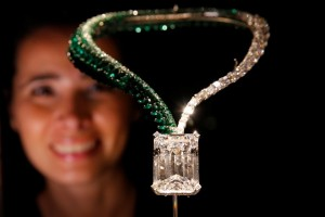 "A staff member poses behind ""The Art of de Grisogono,"" a necklace suspending a 163.41-carat, D color, flawless, IIA type diamond, during a preview of Christie's auction sale in Geneva, Switzerland November 8, 2017. REUTERS/Denis Balibouse"
