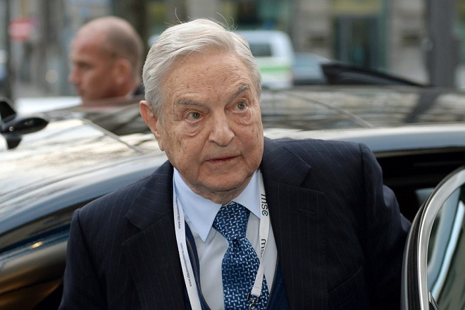 epa04606546 US Investor George Soros arrives at the 51st Security Conference at the Hotel Bayerischer Hof in Munich, Germany, 06 February 2015. During the Security Conference, several dozen Heads of State or Government, Foreign and Interior Ministers meet.  EPA/ANDREAS GEBERT