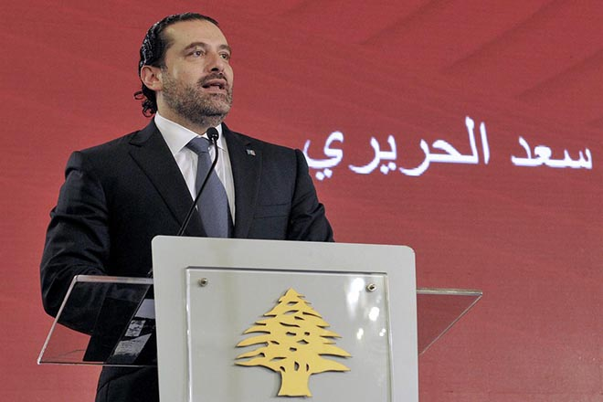 epa06307554 A handout photo made available by Dalai Nohra  shows Lebanese Prime Minister Saad Hariri speaks During a conference under slogan Together against piracy' in Beirut, Lebanon, 03 November 2017 (Issued 04 November 2017). Hariri announced on 04 Novermber 2017 that he resigns from the Prime Minister's office. According to media reports, Hariri said that the current political climate reminds him with the time before the assassination of his father, former Lebanese Prime Minister Rafic Hariri, and he also mentioned Iran's influence in his country, and the region. Hariri came into office for his second term on 18 December 2017.  EPA/DALATI NOHRA HANDOUT  HANDOUT EDITORIAL USE ONLY/NO SALES