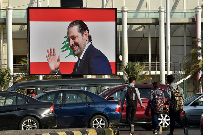 epa06328650 A billboard depicting Prime Minister Saad Hariri, who has resigned as Lebanese Prime Minister, hangs on a street in Beirut, Lebanon, 14 November 2017. Hariri resigned on 04 November 2017 while he was at Saudi Arabia, a move that the media reports as a part of the Saudi-Irani proxy conflict.  EPA/WAEL HAMZEH