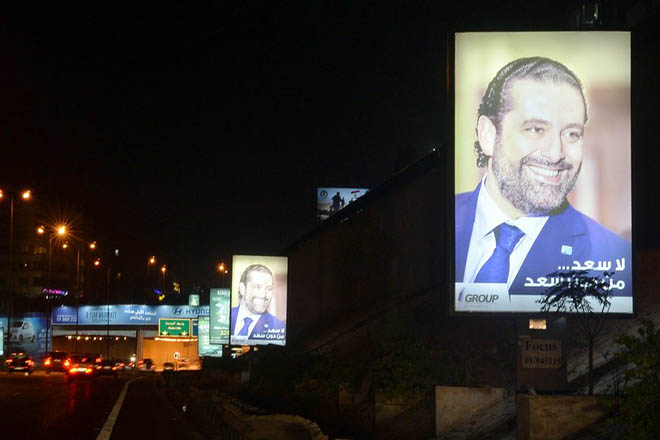 epa06337926 Posters depicting Saad Hariri, who has resigned as Lebanese Prime Minister, with Arabic words that read 'there is no happiness without Saad' are displayed on a street in Beirut, Lebanon, 18 November 2017. Hariri, who announced on 04 November his resignation and remained since then in the Saudi capital, has arrived in France on 18 November for his meeting with French President Emmanuel Macron at the Elysee Palace.  EPA/WAEL HAMZEH