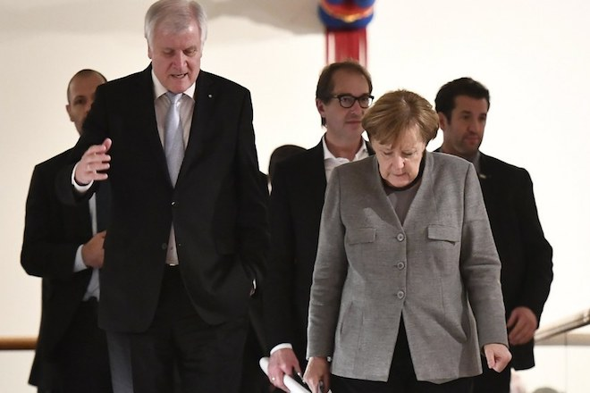 epa06339327 Bavaria state governor and chairman of the German Christian Social Union (CSU) party, Horst Seehofer (L), and German Chancellor Angela Merkel join a break during a final session of exploratory talks of four political parties at the federal state residence of Baden Wuerttemberg in Berlin, Germany, 19 November 2017. The Christian Democratic Union (CDU), the Christian Social Union (CSU), the Greens and the Free Democratic Party (FDP) are holding talks to form the next Government after the general elections in September 2017.  EPA/CHRISTIAN BRUNA