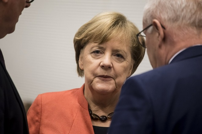 epa06340771 German Chancellor Angela Merkel, of the Christian Democratic Union (CDU), arrives for a parliamentary group meeting at the German Bundestag in Berlin, Germany, 20 November 2017. Despite the failing of the explanatory talks between the Christian Democratic Union (CDU), the Greens and the Free Democratic Party (FDP) to form the next government after the general elections in September, the Social Democrats keep on refusing, being part of a new grand coalition between CDU and SPD.  EPA/CHRISTIAN BRUNA