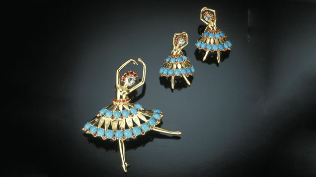 Van Cleef & Arpels ballerina brooch and matching clip earrings of gold, diamonds, turquoise and ruby.