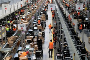 epa06328667 A general view of employees working at the new Amazon Logistic and Fulfillment Center in Dortmund, Germany, 14 November 2017. The Fulfillment Center is reportedly one of Amazon's newest and most modern European facilities and said to create hundreds of new jobs in Dortmund.  EPA/FRIEDEMANN VOGEL