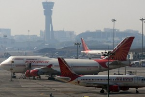 epa05072623 Air India airlines aircraft are parked at the Chhatrapati Shivaji International Airport in Mumbai, India, 17 December 2015. According to reports, an Air India technician died after being sucked into the engine of a running aircraft at Mumbai airport.  EPA/DIVYAKANT SOLANKI