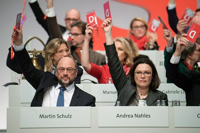epa06374550 The chairman of the SPD, Martin Schulz (L) and the chairwoman of the SPD parliamentary group, Andrea Nahles (R), during the party convention of the German Social Democratic Party (SPD), in Berlin, Germany, 07 December 2017. During the three-day event delegates will discuss and decide about the possibility of starting talks with the Christian Democratic Union (CDU) to form again a grand coalition government.  EPA/CLEMENS BILAN