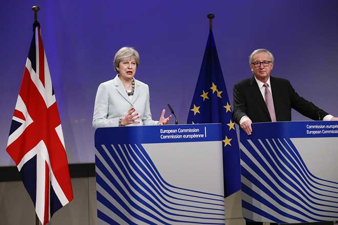 epa06375782 British Prime Minister Theresa May speaks at a press conference with EU Commission President Jean-Claude Juncker (L) prior to a meeting on Brexit Negotiations in Brussels, Belgium, 08 December 2017. Reports state that Theresa May is in Brussels after talks on the issue of the Irish border where she will meet with European Commission President Jean-Claude Juncker and EU negotiator Michel Barnier.  EPA/OLIVIER HOSLET