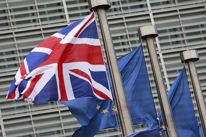 epa06376221 British and European flags in front the  European Commission headquarters during a meeting of British Prime Minister Theresa May and President Jean-Claude Juncker on Brexit Negotiations in Brussels, Belgium, 08 December 2017. Reports state that Theresa May is in Brussels after talks on the issue of the Irish border where she will meet with European Commission President Jean-Claude Juncker and EU negotiator Michel Barnier.  EPA/OLIVIER HOSLET