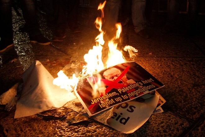 Palestinian demonstrators burn posters of the US president in Bethlehem's Manger Square in protest to him declaring Jerusalem as Israel's capital on December 6, 2017. Abbas said the United States can no longer play the role of peace broker after Donald Trump's decision on Wednesday to recognise Jerusalem as Israel's capital. / AFP PHOTO / Musa AL SHAERMUSA AL SHAER/AFP/Getty Images