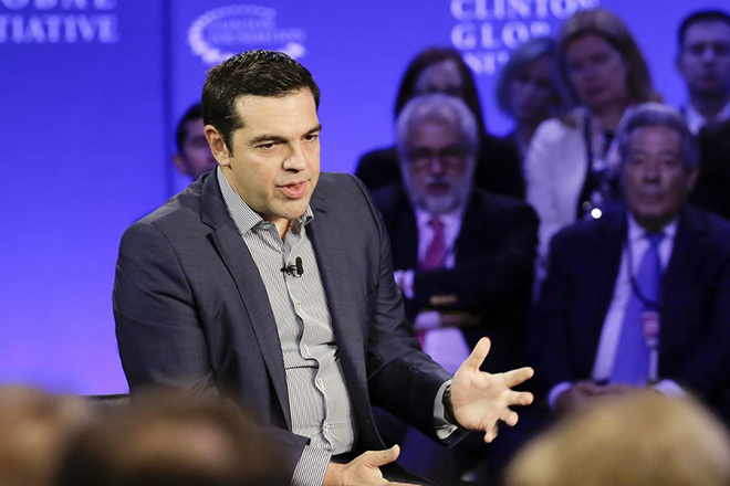 epa04953606 Greek Prime Minister Alexis Tsipras speaks at the Clinton Global Initiative in New York, USA, 27 September 2015.  EPA/RAY STUBBLEBINE